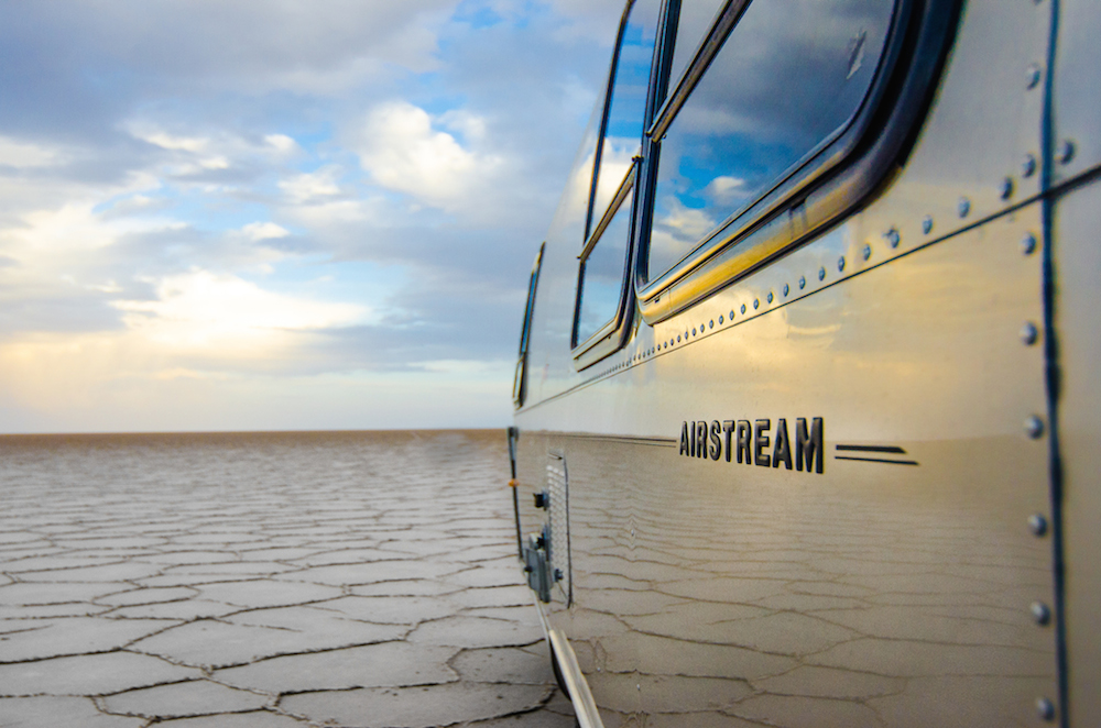 uyuni-salt-flats-bolivia-sunset-airstream-camping-cox-and-kings-jenny-adams-freelance-writer-daniel-scheffler-lanee-lee-voyage-vixens-buddha-drinks-fanta-3