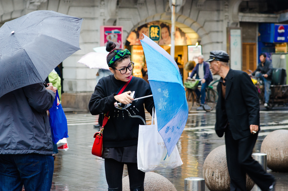 Shanghai-Nanjing-Road-China-shopping-umbrellas-rainy-day-Jenny-Adams-travel-Buddha-drinks-fanta-5046