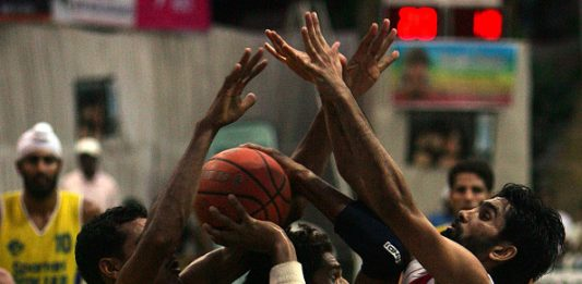 MUMBAI, INDIA - OCTOBER 16, 2006: Basketball - Punjab skipper Jagdeep (15) is fenced by Indian Army's Jai Ram Jat (13) and Jaswant Singh (8) during their match in the Ramu Memorial Basketball Tournament at Indian Gymkhana. (Photo by Ritesh Uttamchandani/Hindustan Times via Getty Images)