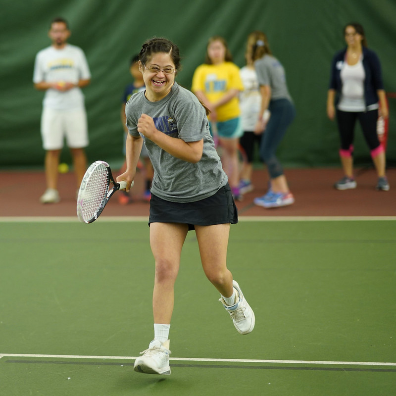 Tennis Athlete Actively Playing