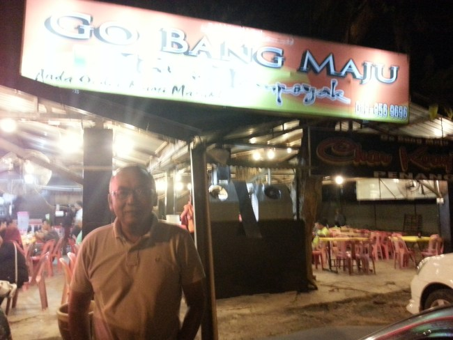 NIK IN FRONT OF GOBANG MAJU RESTAURANT