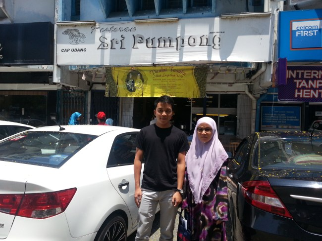 SHAM & ZULHILMI IN FRONT OF RESTAURANT