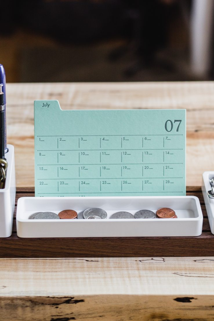 desk with calendar and pens