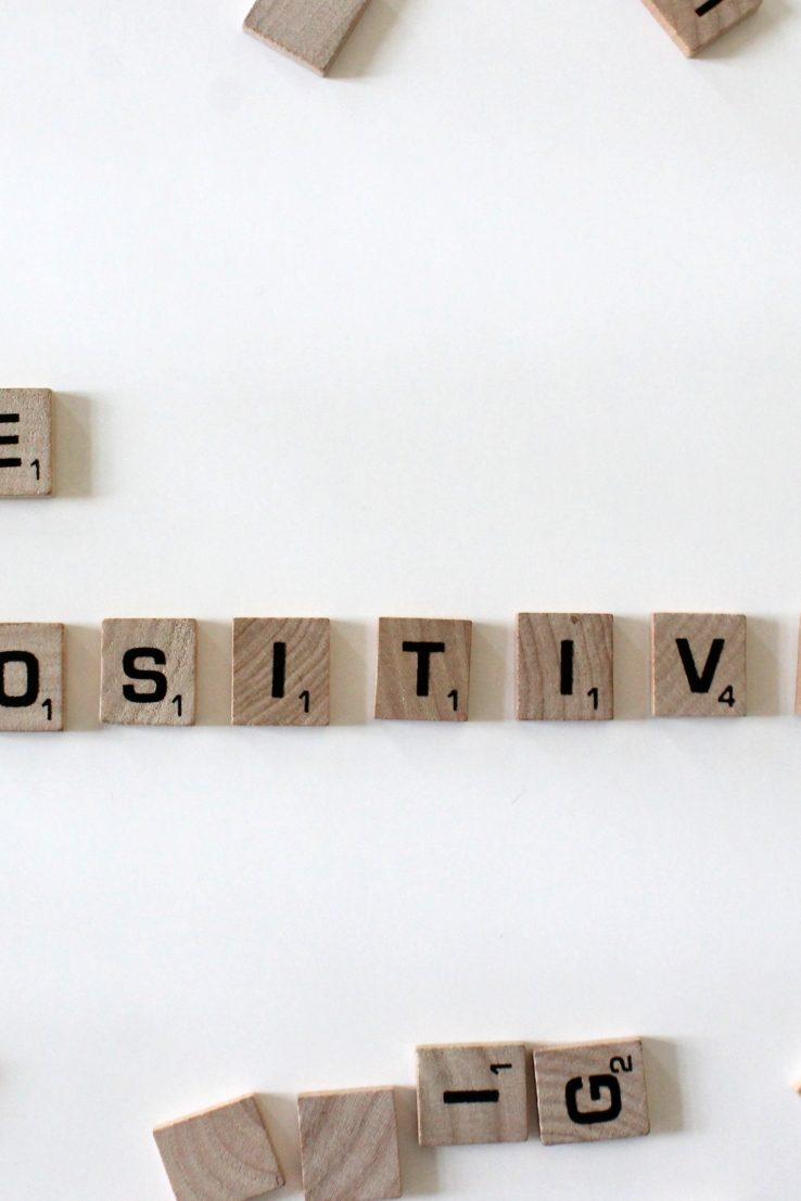 scrabble tiles reading be positive