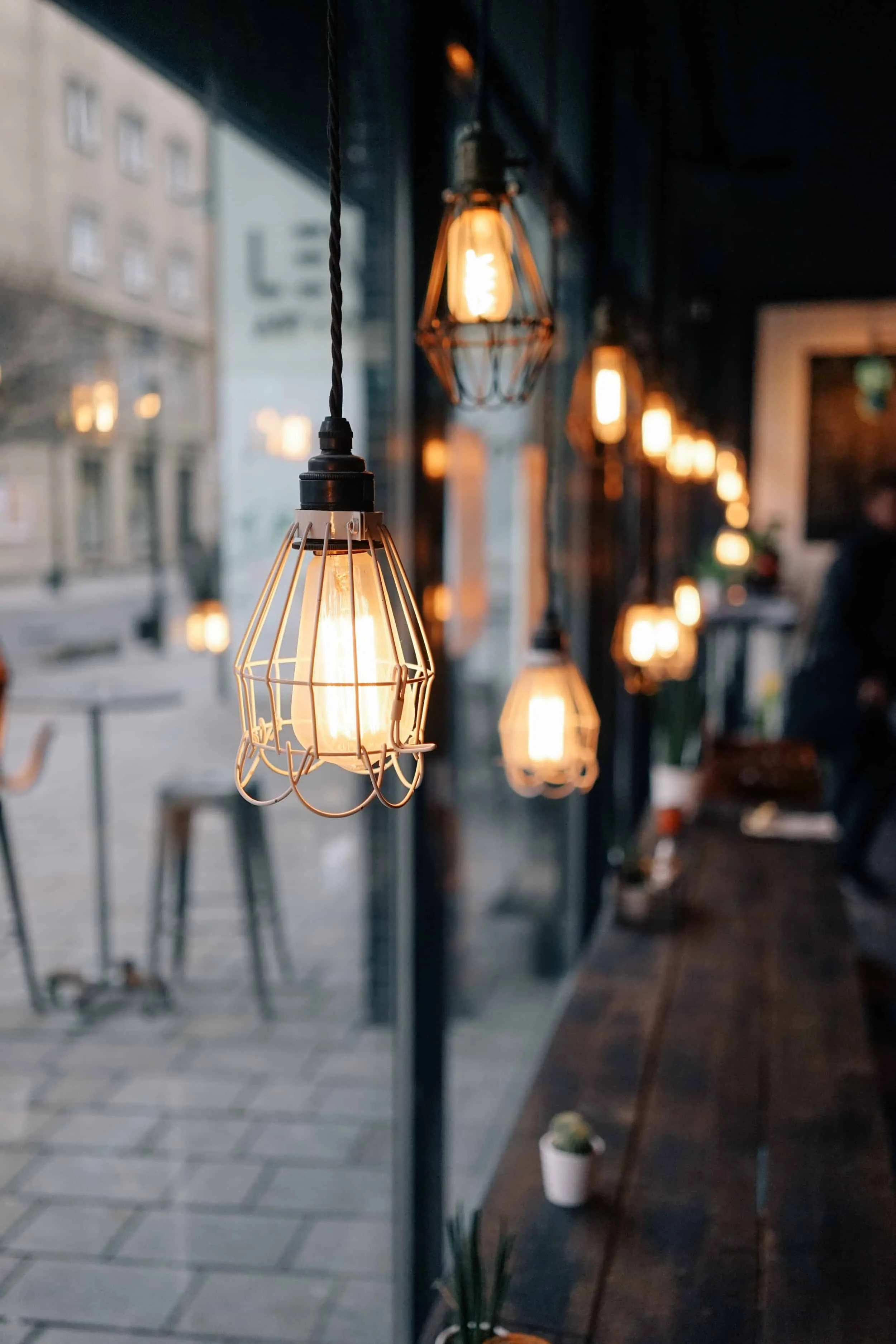 hanging lights in a row at a coffee shop window