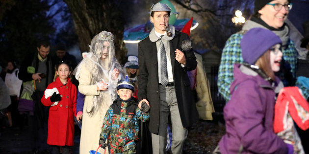Canada's PM Trudeau walks with his son Hadrien while participating in Halloween in Ottawa