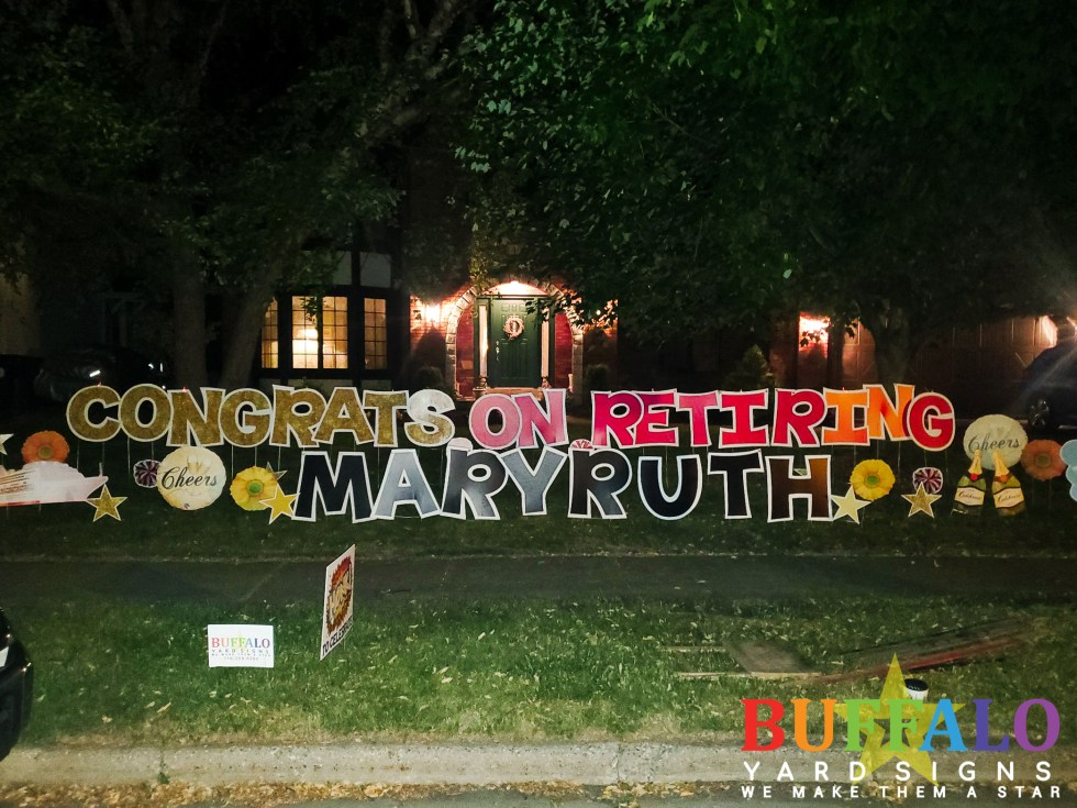 Custom retirement yard sign that reads Congrats on Retiring with champagne bottles, daisies, cheers signs