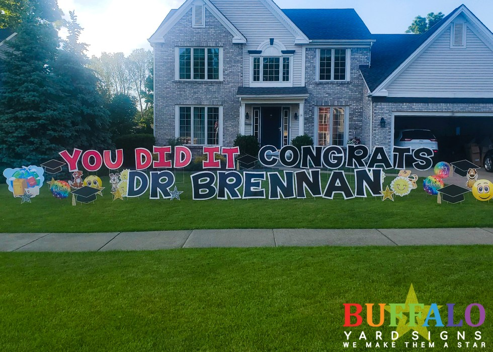 Med school graduation yard sign that says You Did It Congrats