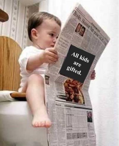 kid reading newspaper on toilet