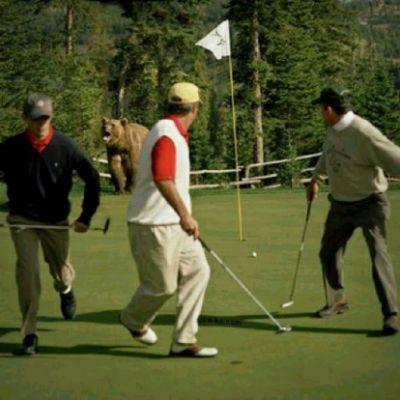 golfers with bear