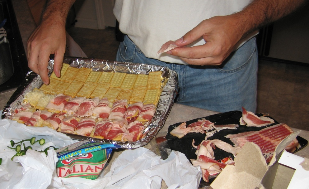 bacon-wrapped club crackers, with cheese, in preparation