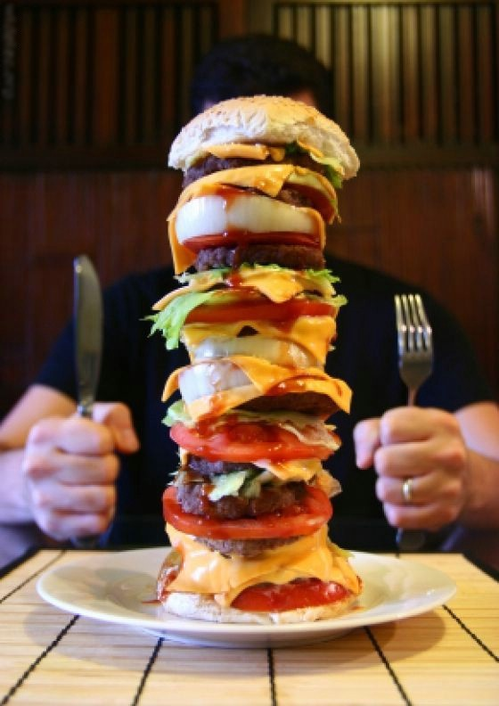 burger stacked with various items