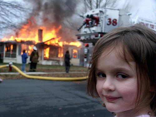 child looking suspicious by house fire