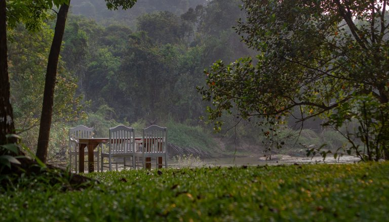Quiet by the river, CGH Earth - riverside retreat- dining by the river