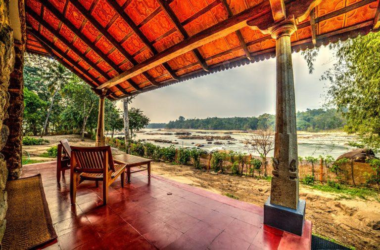 Quiet by the river, CGH Earth - river lodge - verandah view