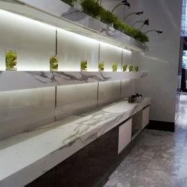 Manhattan Calacatta stone store shelves