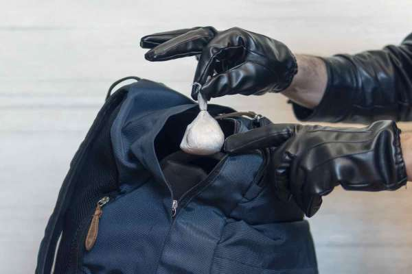 Police officer finds a bag of drugs in a backpack, which will mean a charge of possession, and possibly possession with intent to sell.