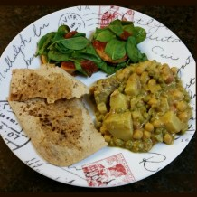 Potatoe/pea/chickpea curry, with a side of baked polenta/spinach/pasta sauce, and buttered whole wheat flatbread sprinkled with cinnamon