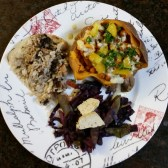 Baked sweet potato, with seasoned chickpeas, with a lemon, tomatoe, parsley, dill, humus dressings. Alongside, leftovers of red cabbage and carrots, and a wrap from Chipotle's