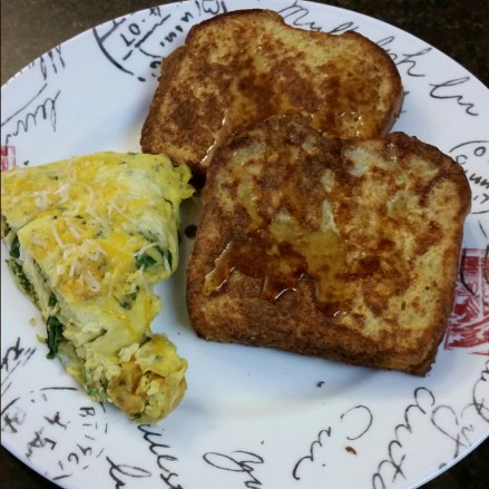 My hubby made breakfast today :) French toast with cinnamon and vanilla, and egg batter. Along with an egg frittata with turnip greens.