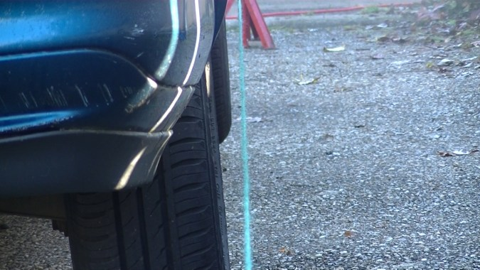 Positionner les chandelles pour que la ficelle soit parallèle à la roue arrière