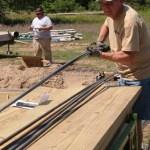 Team member preparing rebar to be cut and sorted