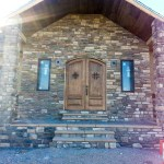 Stone entryway with double front door