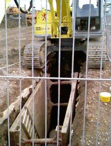 Excavating to lay drainage pipe