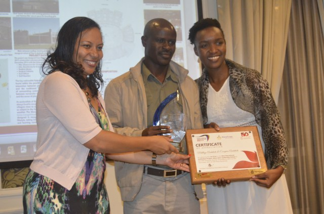 AAK President, Arch. Emma Miloyo presents the Best Educational institution project winner award to Mara Girls Leadership school submitted by Meelby Architects and Ecospace architects.