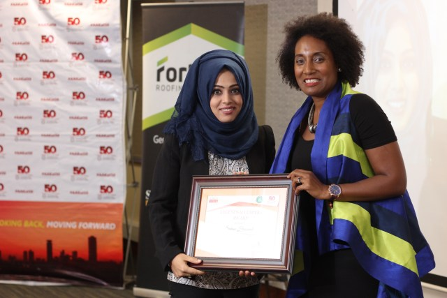 Sakina Hassanali of Hass Consult receiving her award from the WIRE President for being the winner in the Entrepreneurship category.