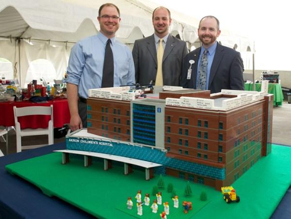 (L-R) Volunteer architects Dan Gilbert and Jonathan Morschl and associate development officer Brian Hollingsworth were instrumental in building the LEGO model.