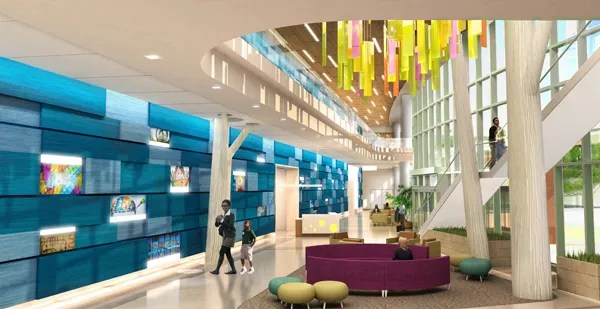 "Abstract design features in the future lobby play into the ""things familiar"" and backyard ideas. The blue wall represents an abstract fence. The design team is also working on large tree sculptures and a ceiling sculpture element to symbolize a tree canopy of leaves."