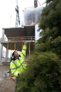 Tom Conti with Christmas tree he and his family donated for the construction site.