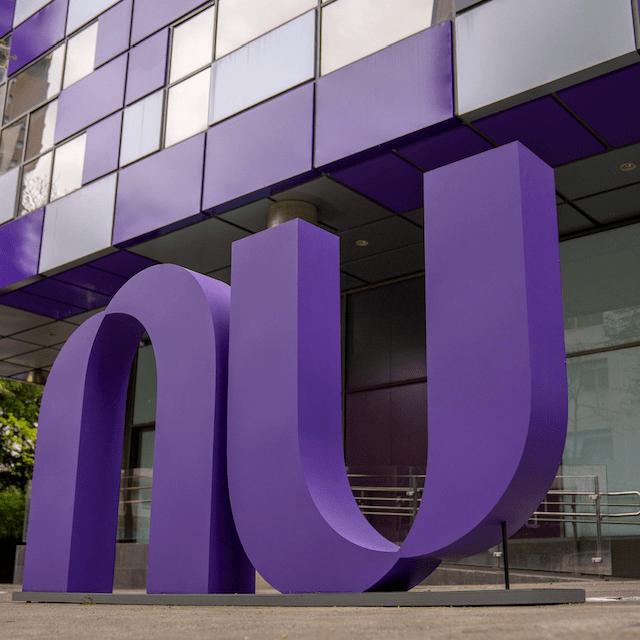 Nubank logo behind its headquearters in Såo Paulo, Brazil. Nubank and Creditas announce partnership.
