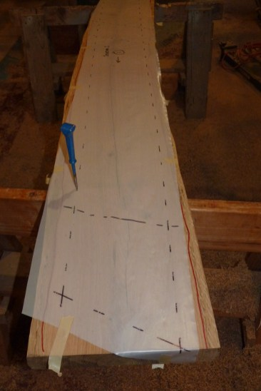 Using 6 mil vapor barrier plastic sheet, a pattern for each futtoch is taken from the framing platform. The pattern is made about an inch over-sized to allow for inaccuracies and blade width. It is transferred to the board by marking through the pattern with an awl.