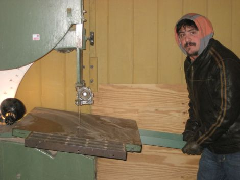 Josh getting a feel for moving the band saw table angle using the improvised handle. Photo by Jim Trish.
