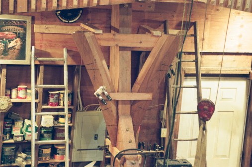 Plumb bobs are hung to the floor to check frame position