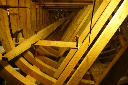 """Temporary """"bench"""" set up inside boat to work on middle clamp piece"""