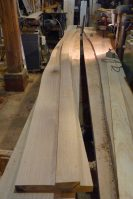 After the first plank is cut to shape, it is used as a template to trace out it's twin for the other side of the boat.