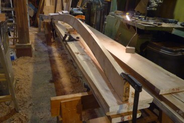 After steam-bending, each plank required some hand planing for final fitting and to add the caulking bevel. Holding the plank for planing wasn't always easy!