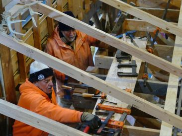 Ron and Ralph working the clamps. Photo by Tom Heller