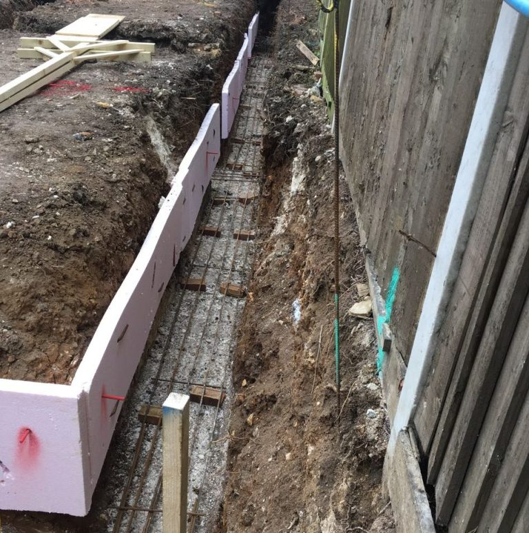 Steel rebar and Claymaster in foundations