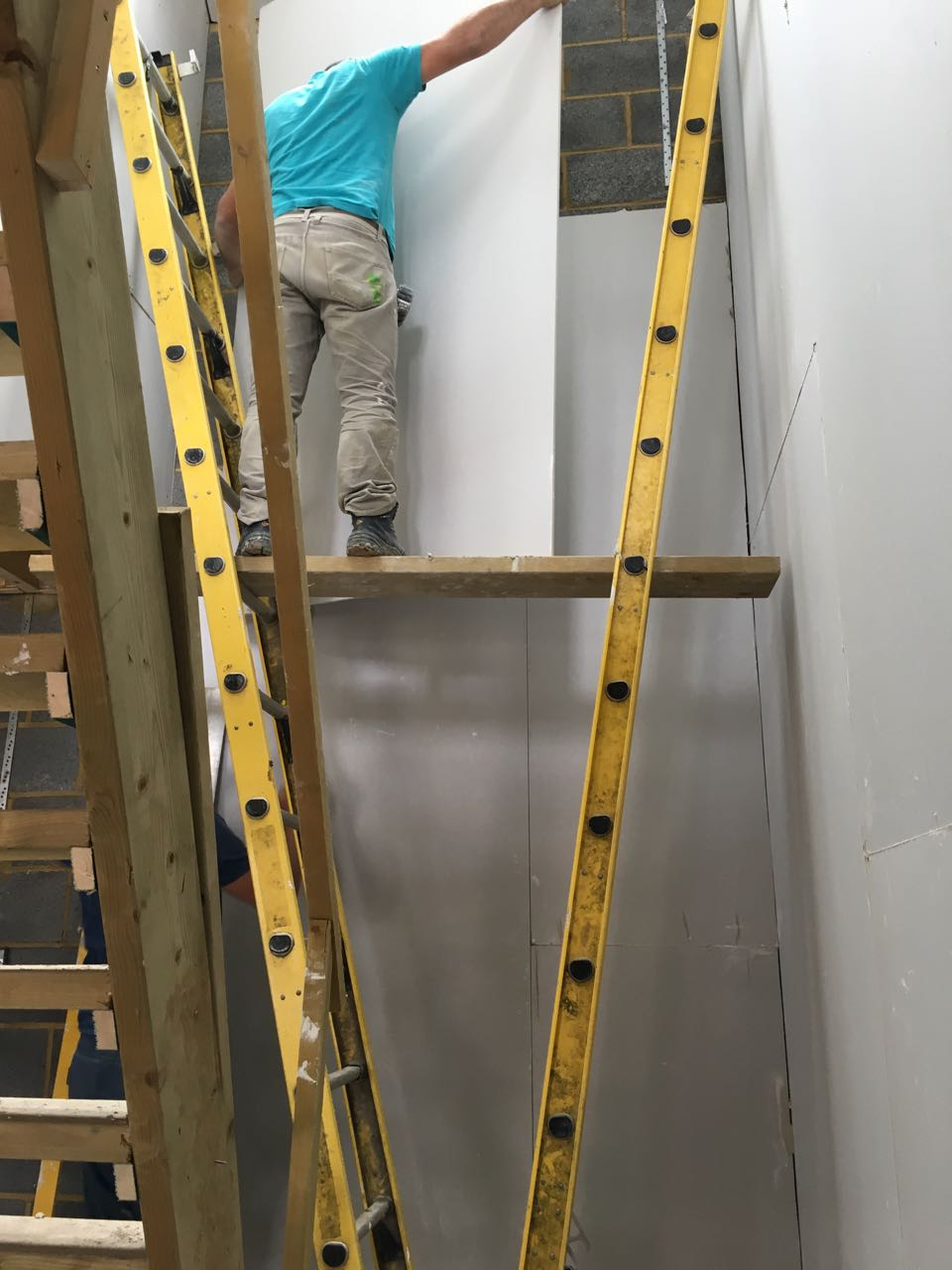 Stairwell plasterboards being fitted