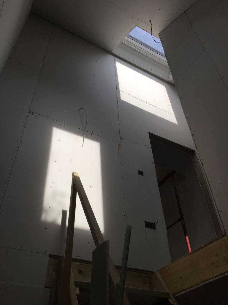 Stairwells plasterboards fitted with veluxes