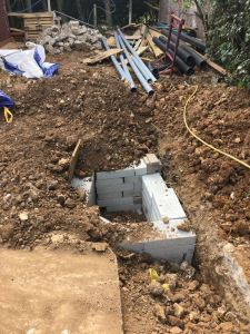 Inspection chamber in trench for electrical ducting