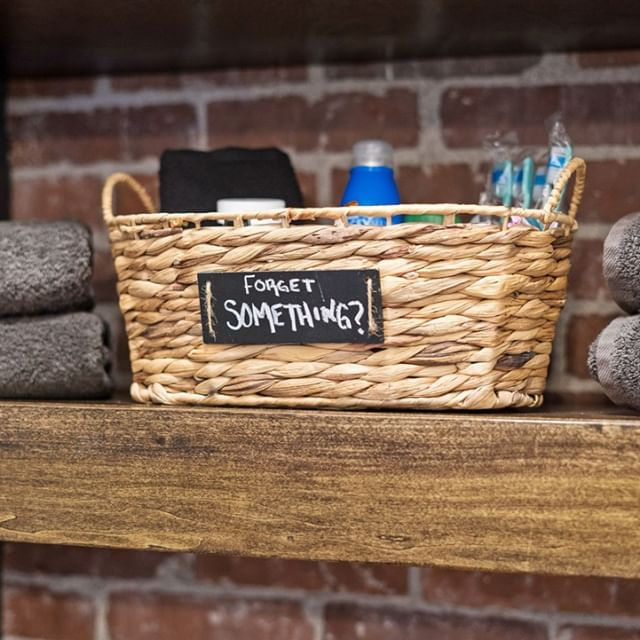 The Nestrs leave a basket of commonly forgotten toiletries for their guests to use at their short term rental.