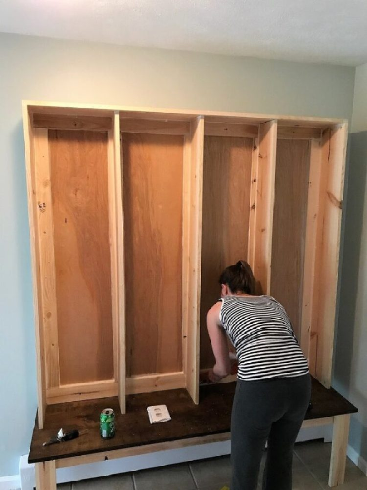 Calking the new DIY bench & locker system in the mudroom.