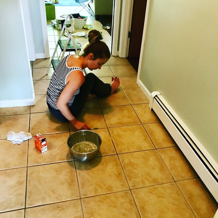 Cleaning the grout on my floors with a toothbrush and soapy water.