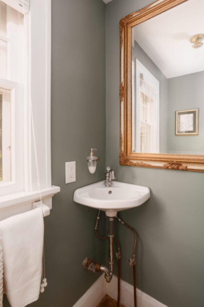 Half bathroom with vintage charm in the historic Colonial home | Building Bluebird