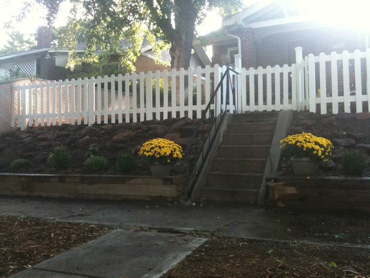 Newly painted picket fence